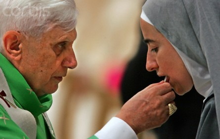 Pope Benedict XVI gives the communion to a nun during a solemn mass in Saint Peter's Basilica at the Vatican
